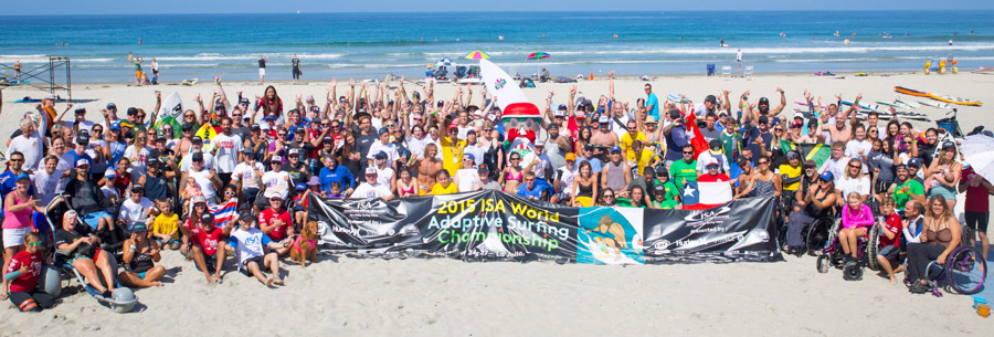 All ISA Adaptive Surfing Clinic participants gather for a photo in La Jolla Shores. Photo: ISA/Val Reynolds