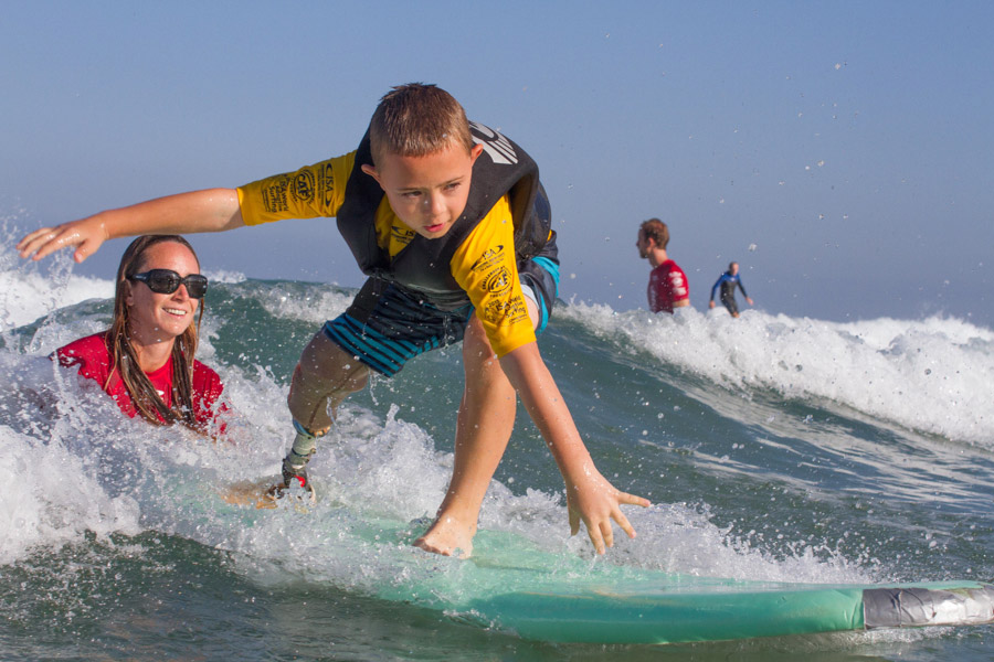 8-year-old surfer, William Thompson, enjoying the waves at La Jolla Shores during the ISA Adaptvie Surfing Clinic. Photo: ISA
