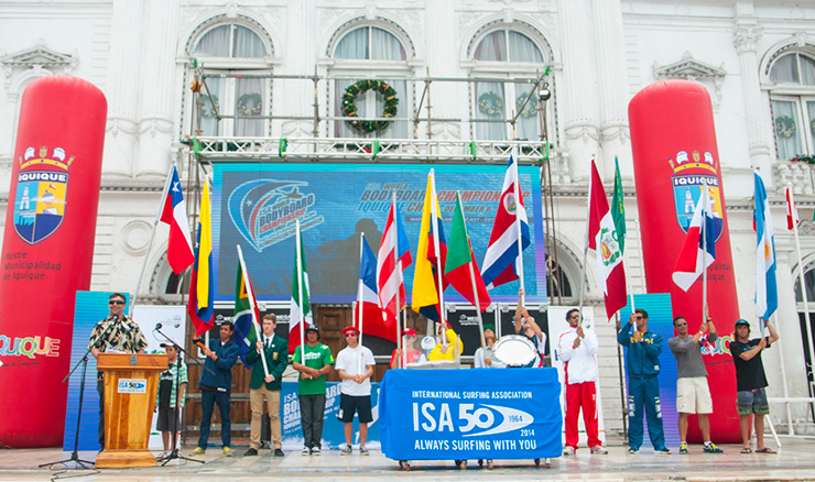 The President of the Chilean Surfing Federation, Juan Agustin Echeverria (far left), amongst the flags of the 13 National Teams, declared the 2014 ISA World Bodyboard Championship officially open. Photo: ISA/Rommel Gonzales