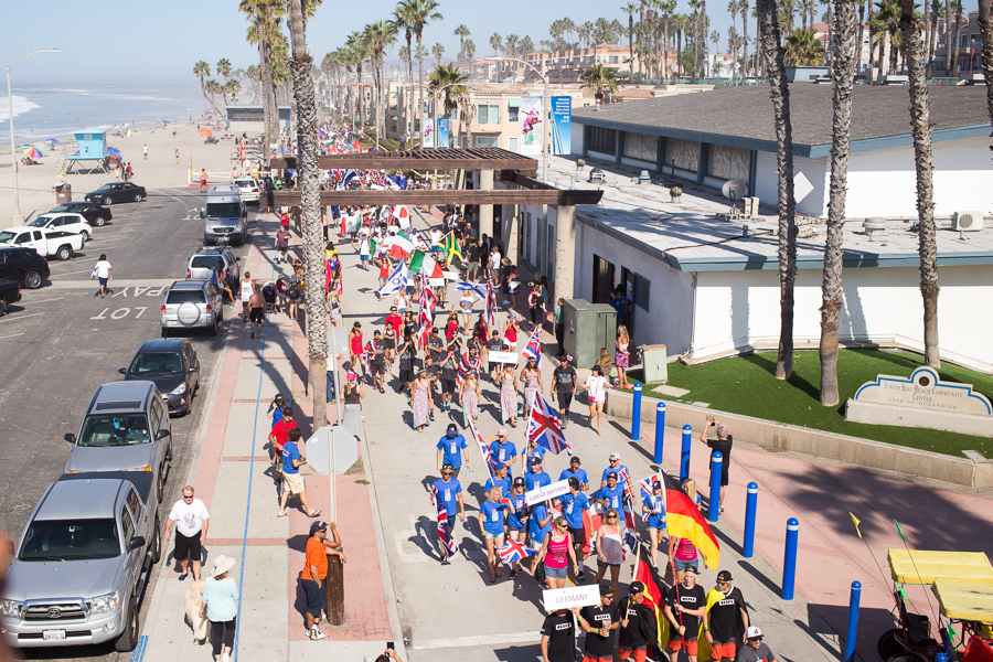 The 36 National Delegations parade down the Oceanside boardwalk, kicking off the Opening Ceremony of the 2015 VISSLA ISA World Junior Surfing Championship. Photo: ISA/Chris Grant