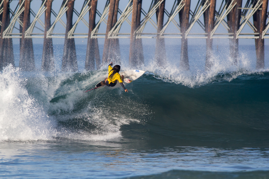 El Salvador's Katy Diaz smashes the end section of a wave on the south side of Oceanside Pier. Photo: ISA/Chris Grant