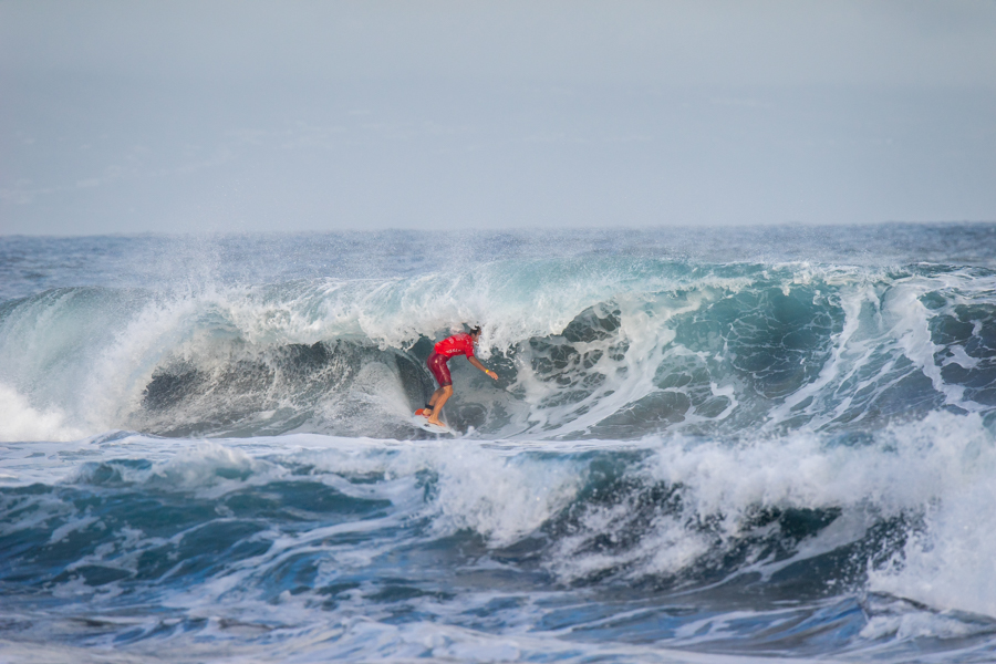 Mathis Crozon (FRA) shows his excellent wave selection by finding a rare barrel on the third day of competition. Photo: ISA / Sean Evans