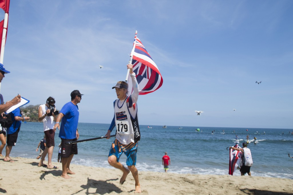 ConnerBaxter propelling Team Hawaii to the Team Bronze Medal with his individual Gold Medal in the Men's SUP Technical Race. Photo: ISA/Brian Bielmann