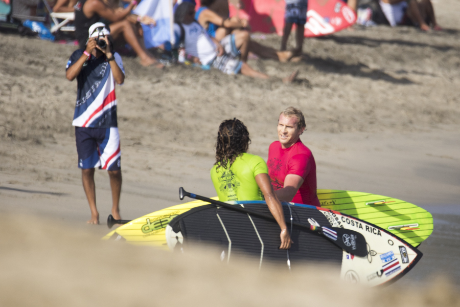 Australia's Jackson Close, shaking hands with Costa Rica's Alvaro Solano, showing the spirt of sportsmanship, a common site at ISA World Championships. Photo: ISA/Ben Reed