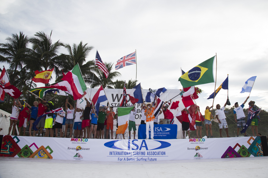 ISA President Fernando Aguerre amongst the flags of the 27 National Teams, officially declared open the 2015 ISA World SUP and Paddleboard Championship Presented by Hotel Kupuri in Sayulita, Mexico. Photo: ISA/Brian Bielmann