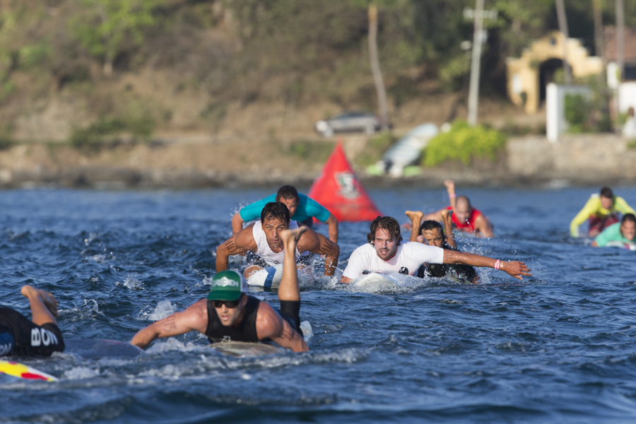 The world's best technical paddleboard racers going full speed ahead while competing in the qualifier for a chance to advance to Sunday's Final. Photo: ISA/Brian Bielmann