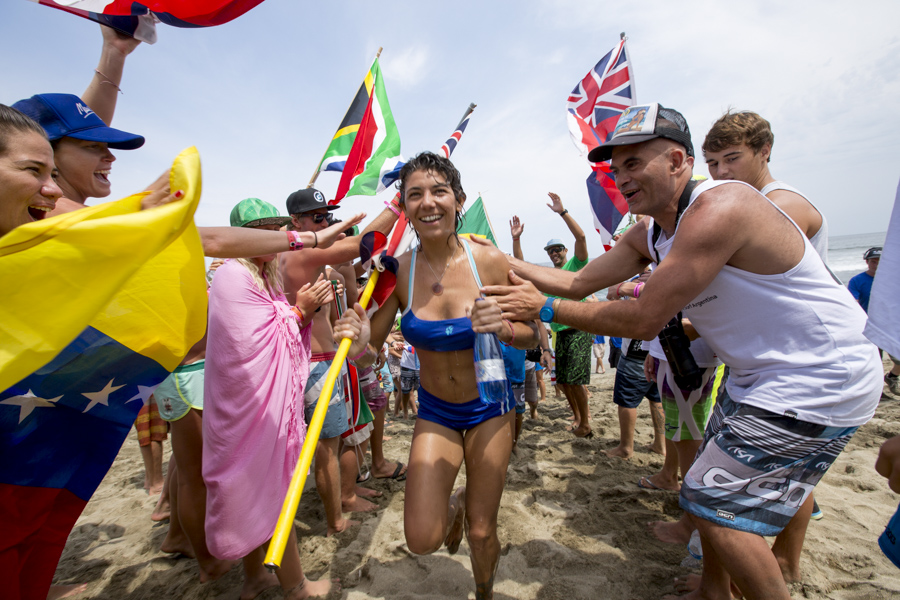 In true ISA spirit, a man-made tunnel composed of international hands, flags and cheers of praise, welcomed Argentina's Florencia Baraboglia, who was the last competitor to cross the finish line. Photo: ISA/Reed