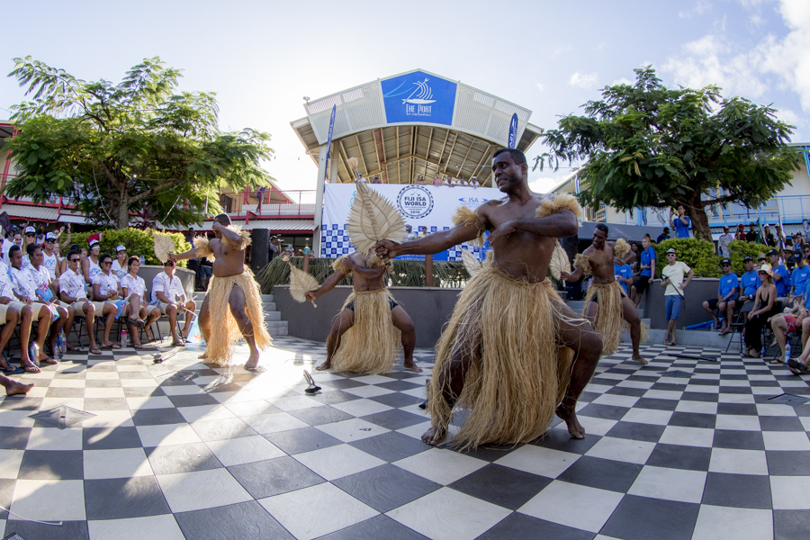 Fijians perform a traditional dance to give the international field of competitors a taste of the local culture. Photo: ISA / Ben Reed