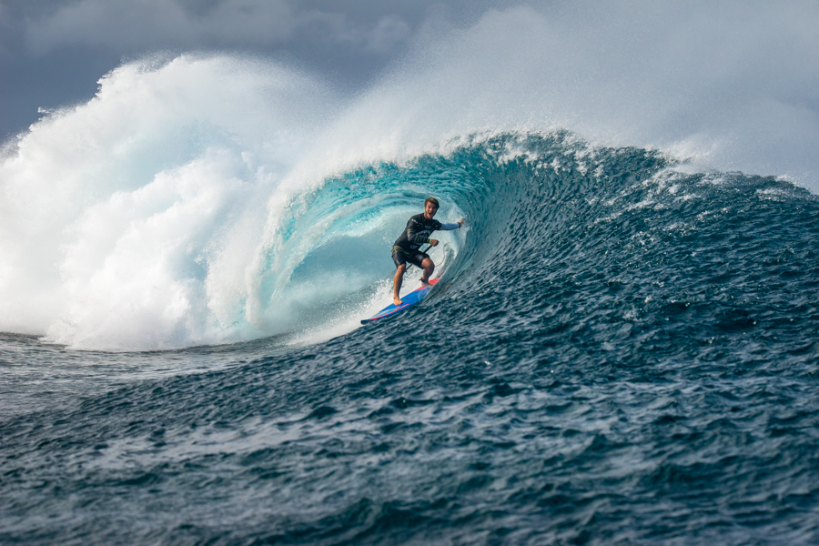 Hawaii's Zane Schweitzer pulls into a barrel at Cloudbreak with his signature Aloha smile. Photo: ISA / Sean Evans