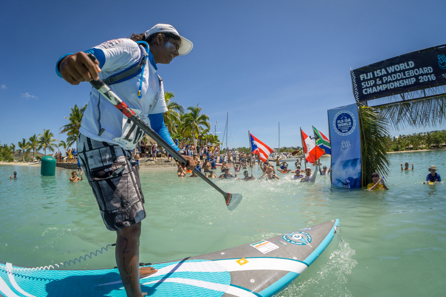 The international SUP community displays their sportsmanship and support, hooting as India's Tanvi Jagadish crosses the finish line. Photo: ISA / Sean Evans