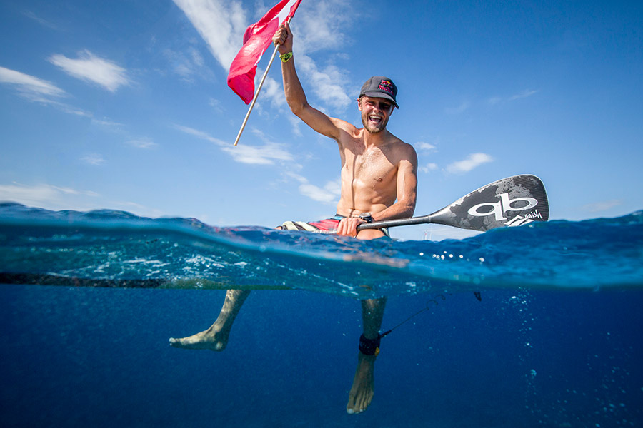 Casper Steinfath soaks in the joy of winning his third Gold Medal in the Men's SUP Technical Race. Photo: ISA / Ben Reed