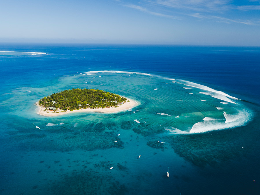 Tavarua Island will be rounded by the athletes during the distance race and Cloudbreak, seen in the background, will host the SUP surfing and Technical Races. Photo: Tourism Fiji