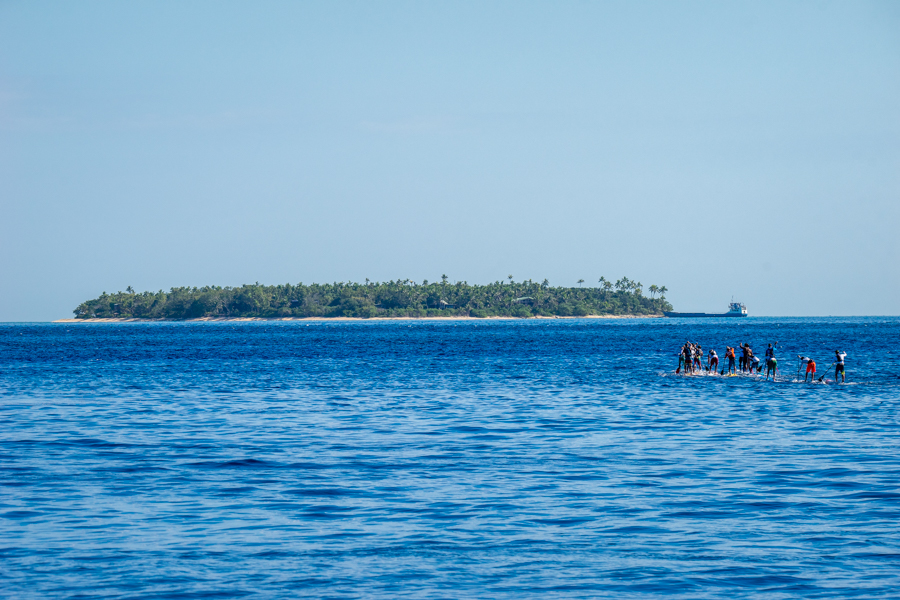 The Men's SUP Paddleboard Distance Race takes off towards the second buoy at Tavarua. Photo: ISA / Sean Evans