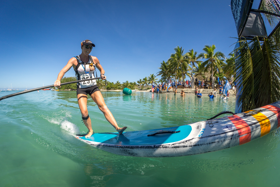 USA's Candice Appleby triumphantly arrives at Musket Cove to claims her second consecutive Gold Medal in the Women's SUP Distance Race. Photo: ISA / Sean Evans