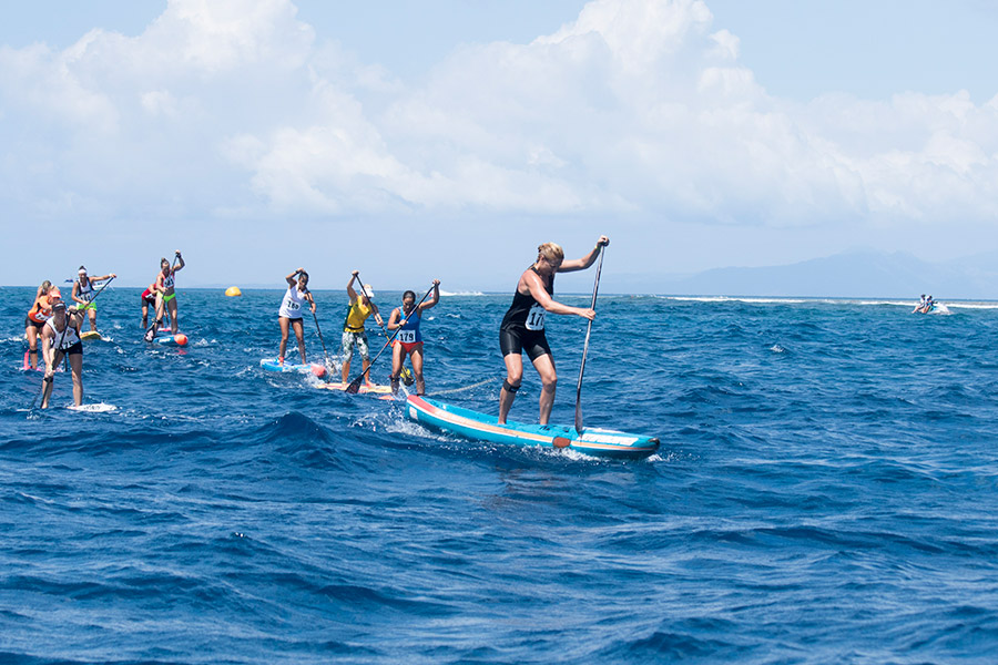 Penelope Armstrong pulls away from the pack during the Women's SUP Technical Race. Photo: ISA / Sean Evans