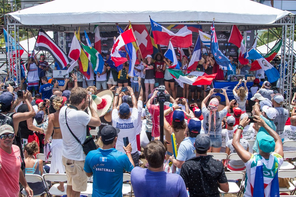 A representative from each of the 26 National Surfing Teams takes to the stage as ISA Vice President Casper Steinfath declares open the 2016 INS ISA World Surfing Games. Photo: ISA / Pablo Jimenez