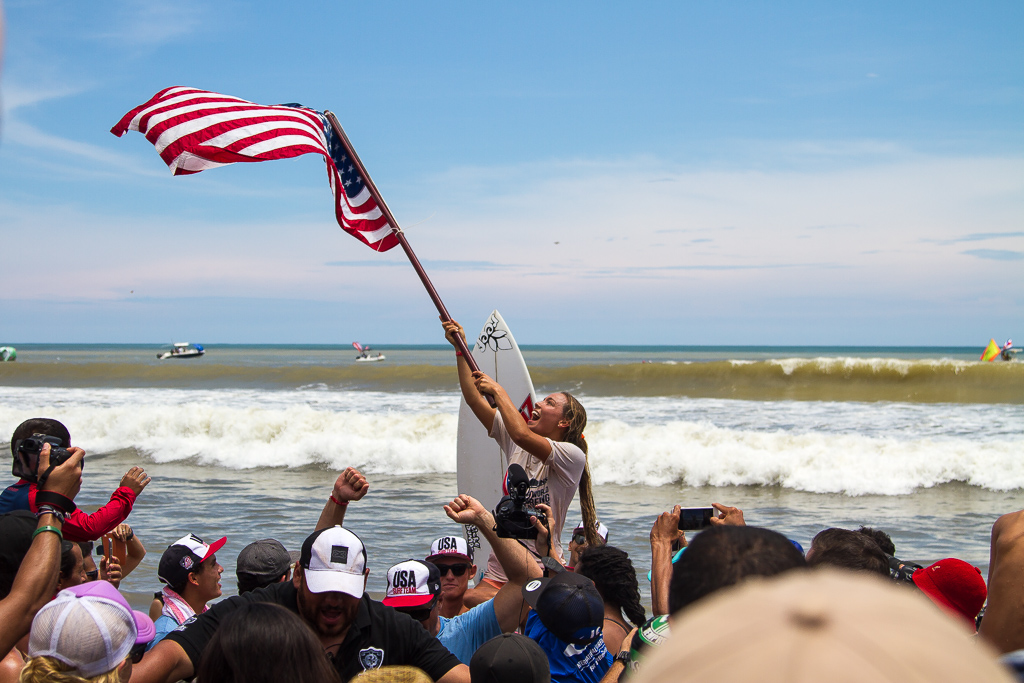 USA's Tia Blanco raises her flag with pride after she wins her second consecutive ISA World Surfing Games Open Women Gold Medal. Photo: ISA / Pablo Jimenez